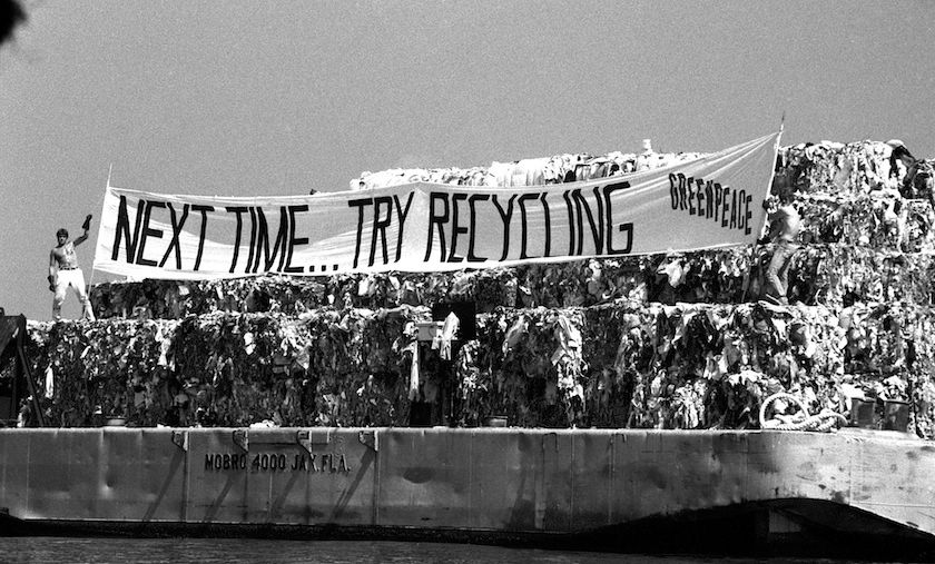 Members of the environmental group Greenpeace display banner